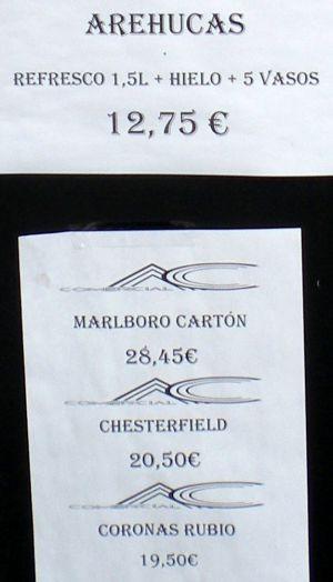 Liquor shop specials on billboard of shop named Estanco