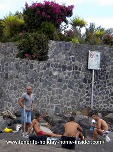 Locals at beach of Park Maritime