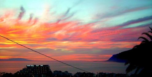 Los Gigantes with a most typical sunset over La Gomera Island with a Barceló Hotel in the foreground.