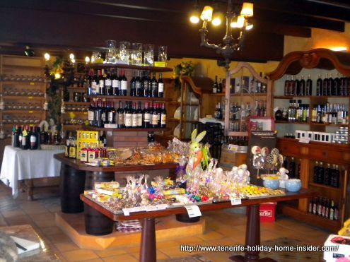 Meson el Monasterio shop with culinary delights and house brands like farm bread pastries and sweets.