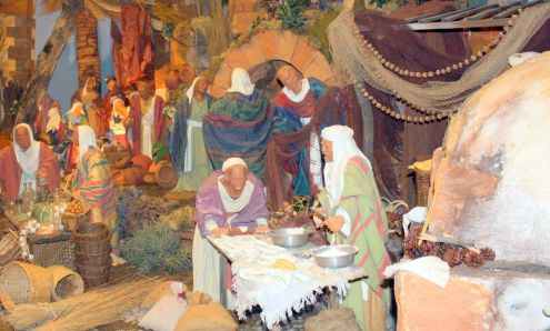 Nativity scenes of village life that remind the beauty of the painter Bruegel with their vivid colors.