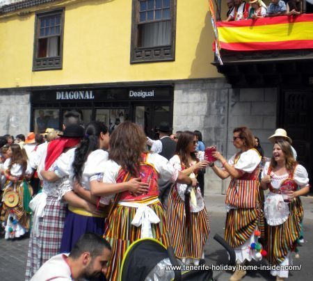 Not matching shop and folk dress seen at Tenerife festivals Romeria of Orotava