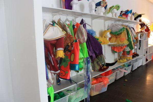 Open shelve with Carnival accessories, such as hats.
