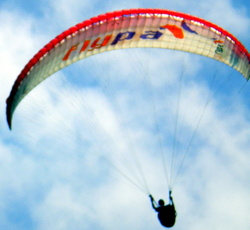 A paraglider approaches the Martianez Bay