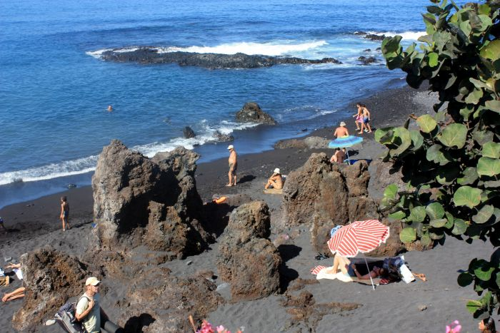 Playa Charcon with lava rocks.