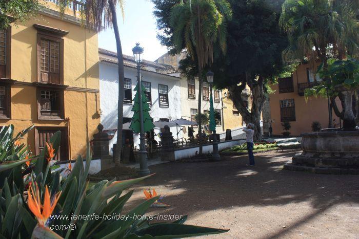 Plaza de la Constitución with a fraction of the mansion of the museum Casa de los Caceres on the left.