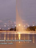 Plaza Espana illuminated at night by its lake in Santa Cruz Tenerife.