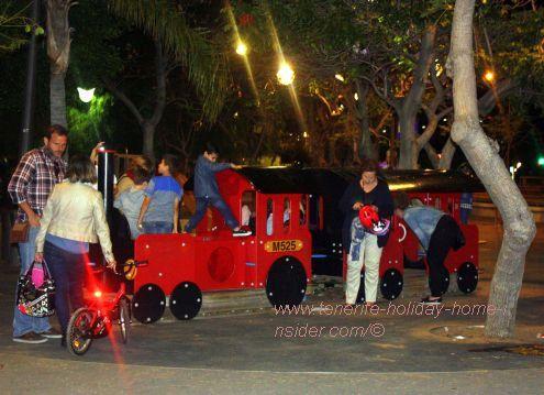 Plaza Espana Santa Cruz night fun with children.