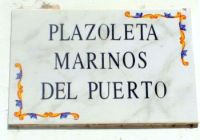 Plaque Plazoleta Marinos del Puerto to honor the men who carry on the day Octava by a town square with that name behind church Virgen del Carmen.