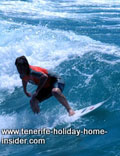 Professional surfer on Martianez beach Tenerife