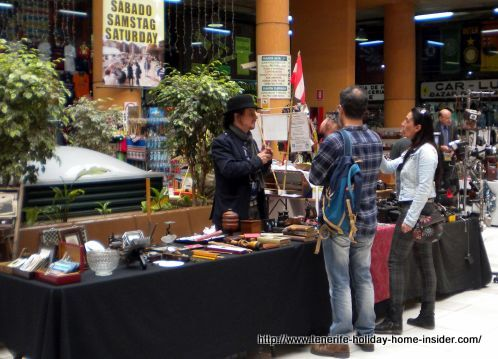 Puerto Cruz Rastro flea market with one of its experts with stall for vintage and antique objects.
