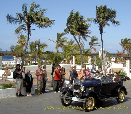 Puerto de la Cruz carnival classic car rally moment captured in the palm-lined Avenida Colon