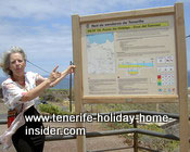 Webmaster standing at Punta Hidalgo billboard