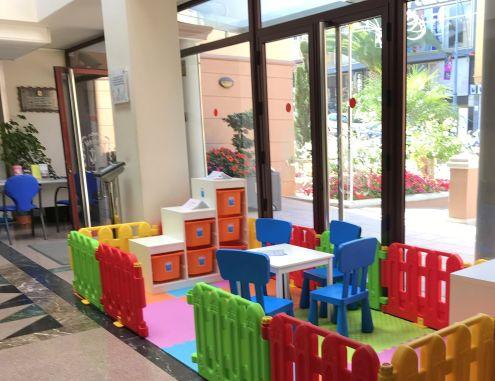 Ayuntamiento Los Realejos child-friendly open children play-corner in its entrance hall