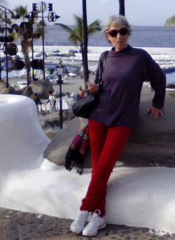 Elderly lady with red Zara denims bought in 2014