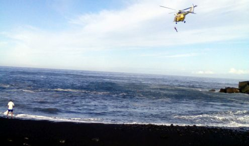 Rescue helicopter circles drowning people on Playa Jardin on October 22, 2016.