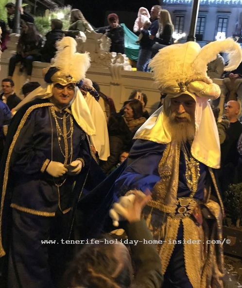 Reyes Magos Tenerife Rey Melchior seems to shake somebody's hand in La Orotava in 2019