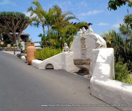 Road altar with fountain a traditional reminder of the past at the entrance of El Monasterio park.