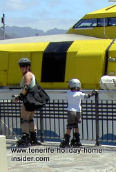 On Roller skates Tenerife touring mother and child