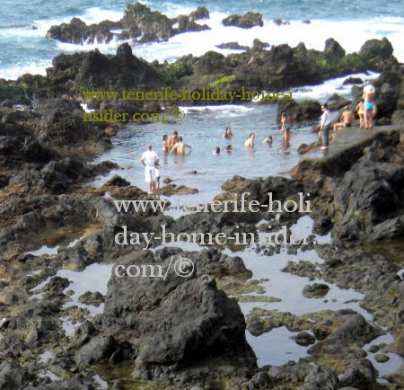 Salt water tide pools with people Puerto Cruz