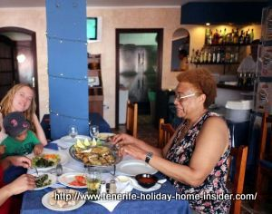 San Pedro Meson Monasterio family lunch with toddler but without mother shown.