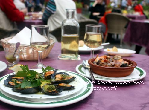 Seafood a la Arcon with two Tapa dishes.