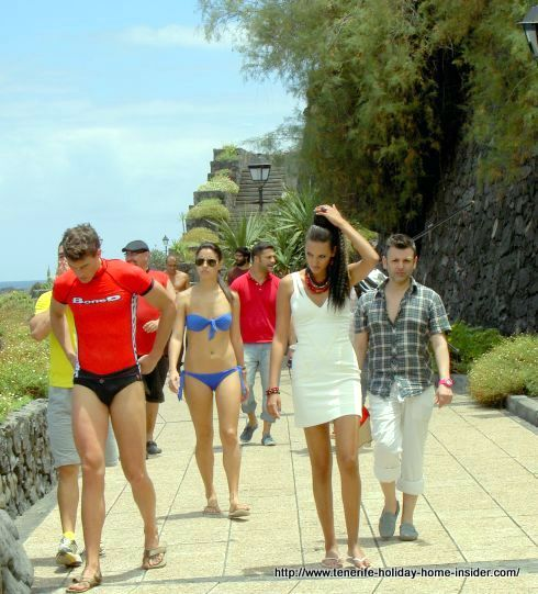 Tenerife seaside promenade with trendy young people that look like photo models.