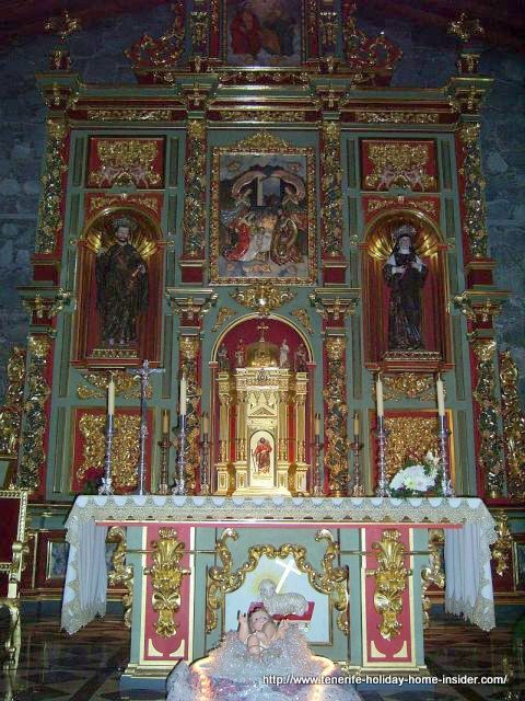 Spanish altar with typical crafts of much gold leaf gilding and plating on top of carved timber.