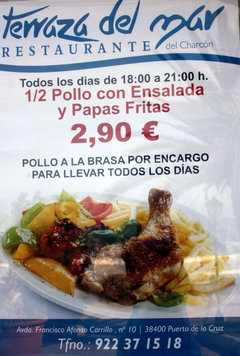 Special supper advertised by the poster of the terrace restaurant Puerto de la Cruz.