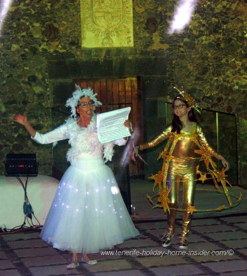 A storyteller with the Star of Bethlehem reads the gospel.