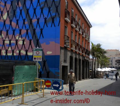 Street art by Victor Ash in the old quarters of Puerto de la Cruz of Tenerife near its little port.
