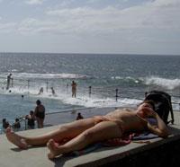sunbathing girl Tenerife Spain Bajamar
