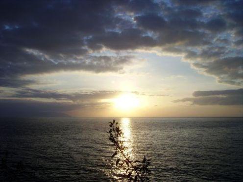 Sundown progressing by the giant cliffs.
