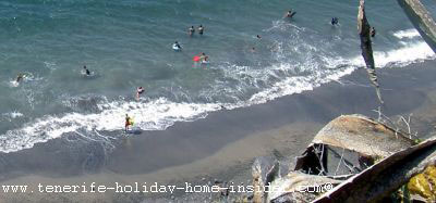 Swimmers and surfers playa el arenal Tenerife