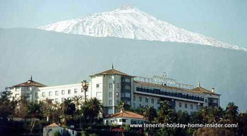 Taoro Hotel with snow capped Teide seen from San Telmo beach