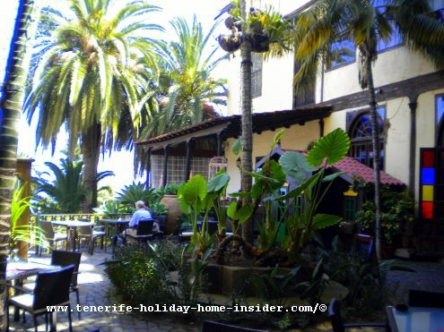 Tasca Casa Lercaro patio surroundings with huge subtropical plants