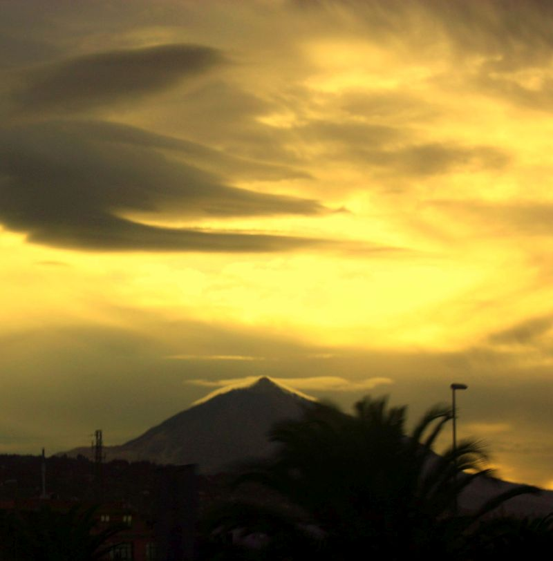 Teide shadow that follows contours of mountain tip by evening of December 01, 2016.