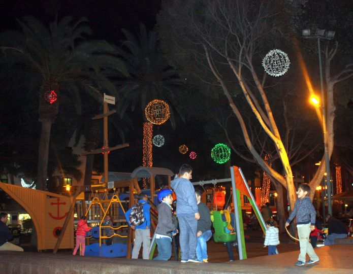 Tenerife Christmas outside nightlife by the town Plaza playground.
