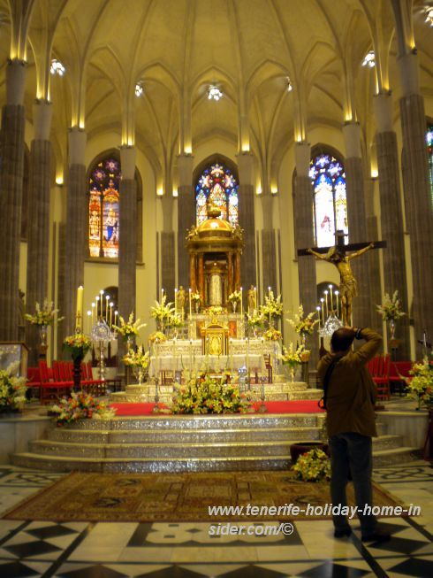 Tenerife Easter Cathedral splendor at San Cristobal de la Laguna where flower decoration abounds during the celebration Mass on Resurrection Sunday.