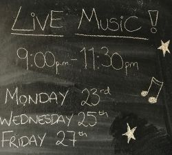 Tenerife sports bar live music blackboard announcement