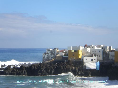 Tenerife weather El Bravo effect on Punta Brava by Puerto de la Cruz as seen by the tall grey and white building