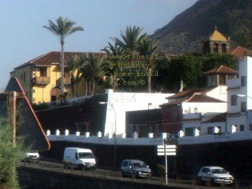 TF 42 coastal-road from Icod de Los Vinos to Buenavista del Norte at the Garachico town entrance with the ex-convent on elevated ground