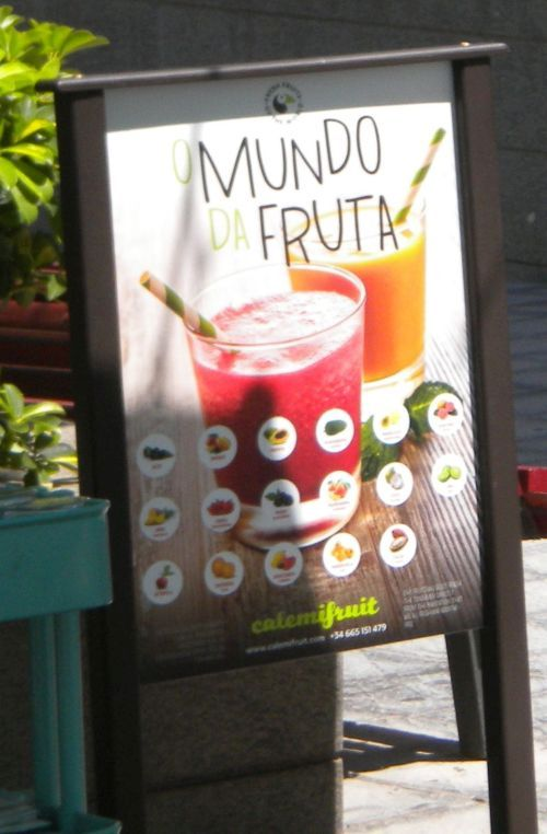 Varied organic fruit juice display.