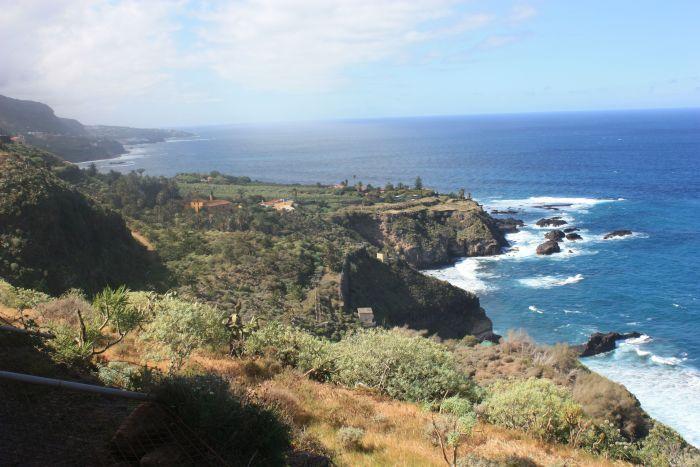 View from third track over the mouth of Barranco Ruiz to Mirador San Pedro, La Casona de Castro and the rocks of El Guindaste.