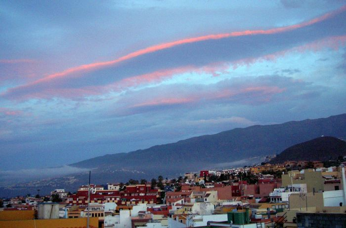 Weather clouds of end of autumn 2015 with almost straight pink lines seen in Los Realejos and Puerto de la Cruz.