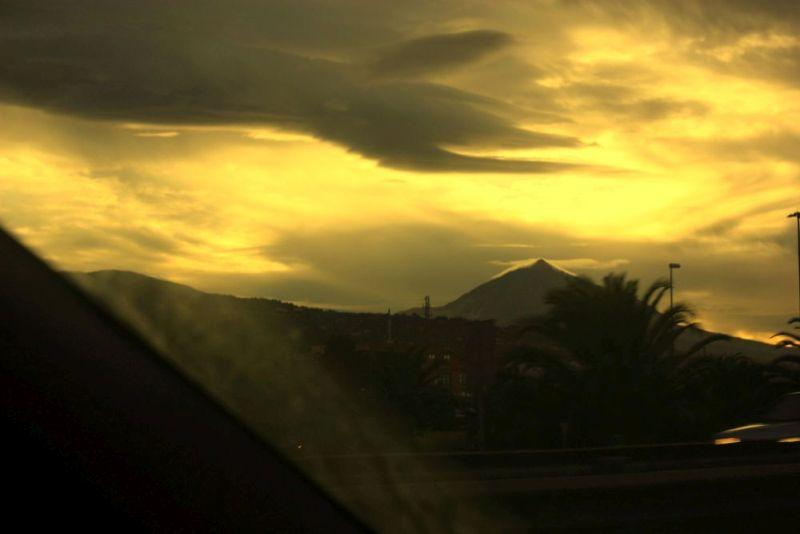 Weather phenomena of Teide clouds and sundown on night sky of 01 December 2016.