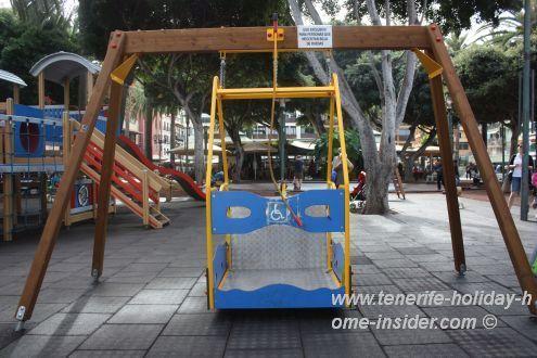 Wheel chair friendly swing on children playground.