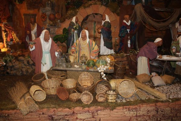 Basket sellers of miniature nativity scene at Puerto de la Cruz exhibition.