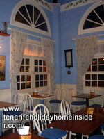 Bentwood chairs with seat cushions in a Tenerife Vegetarian restaurant.
