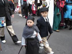 Carnival children dressed for the funeral of the Sardine